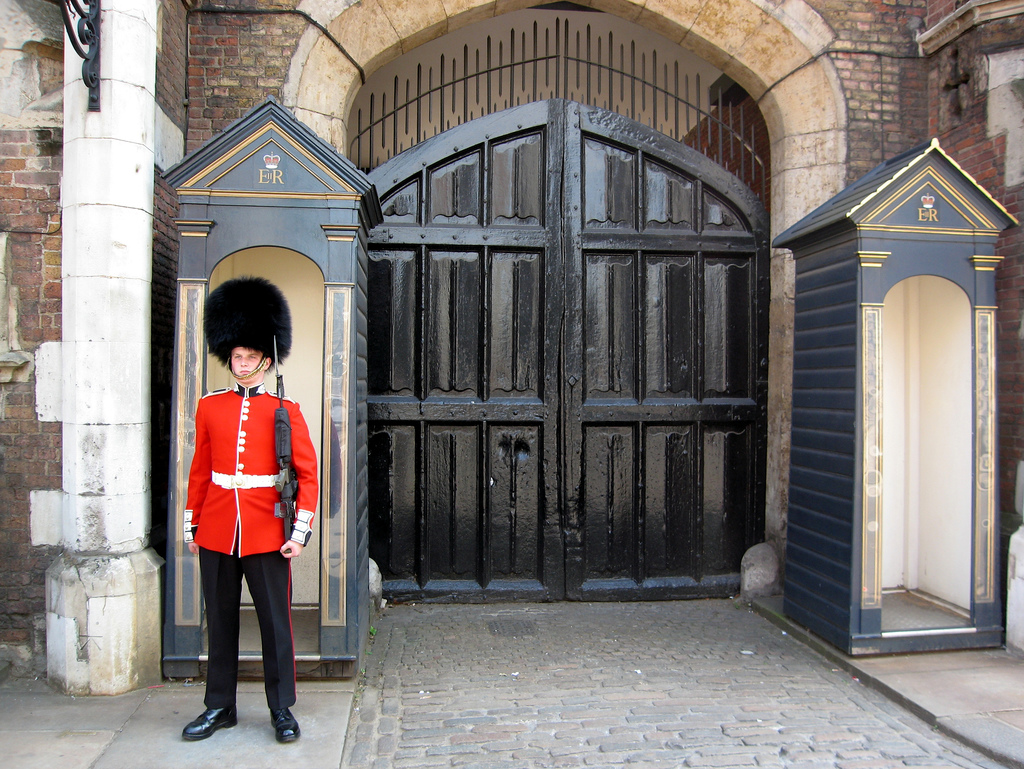 A guard standing in front of a gate